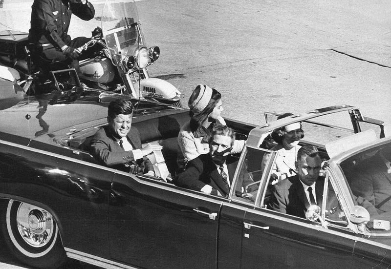 by: CONTRIBUTED PHOTO - Kennedy's motorcade through Dallas began at Love Field. It was less than 10 minutes away from its Dallas Trade Mart destination when the president was shot.