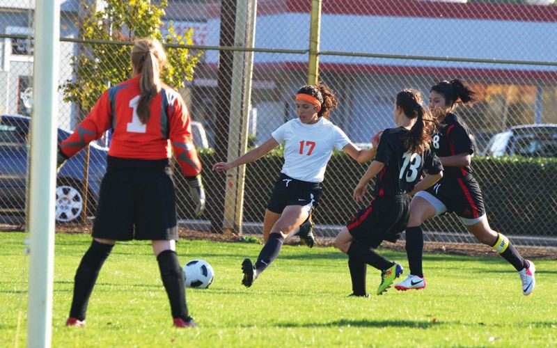 by: FILE PHOTO - Ariel Viera shoots for her 99th career goal during her senior season at Scappoose High School. Now starting on defense for the Portland Pilots, Viera was part of a team which finished 17-3-1 and fell in the second round of the NCAA tournament.