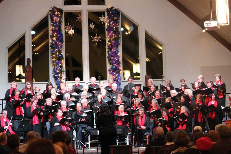 by: SUBMITTED PHOTO - West Linn Community Chorus will present A Season of Lights at 7 p.m. Dec. 14 and 2 p.m. Dec. 15 at Marys Woods Chapel, 17400 Holy Names Drive in Lake Oswego. Under the direction of Tina Paradiso, the 80-member choir will present classical and contemporary songs of Christmas and Hanukkah. A program special highlight will be the singing of a mash-up version of Hallelujah/Jingle Bells. Tickets are $12 for adults, $10 for seniors and students. Children 5 and younger are admitted free of charge. Purchase them at the door or online at boxofficetickets.com or westlinnchorus.org.