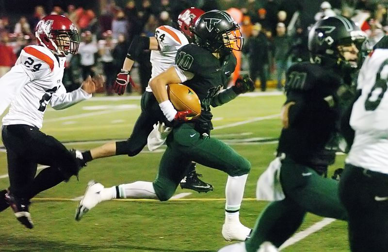 by: DAN BROOD - ON THE GO --Tigard senior Manu Rasmussen is on his way to scoring on a 69-yard run in the Tigers' 42-0 state quarterfinal win over North Medford.