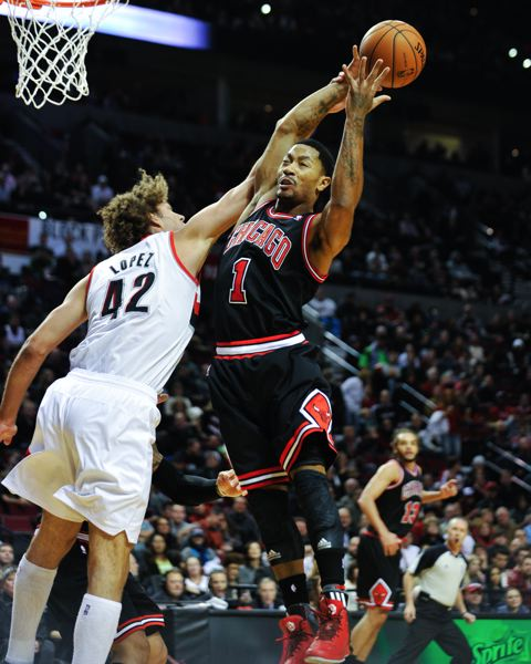 Portland center Robin Lopez blocks Chicago guard Derrick Rose.