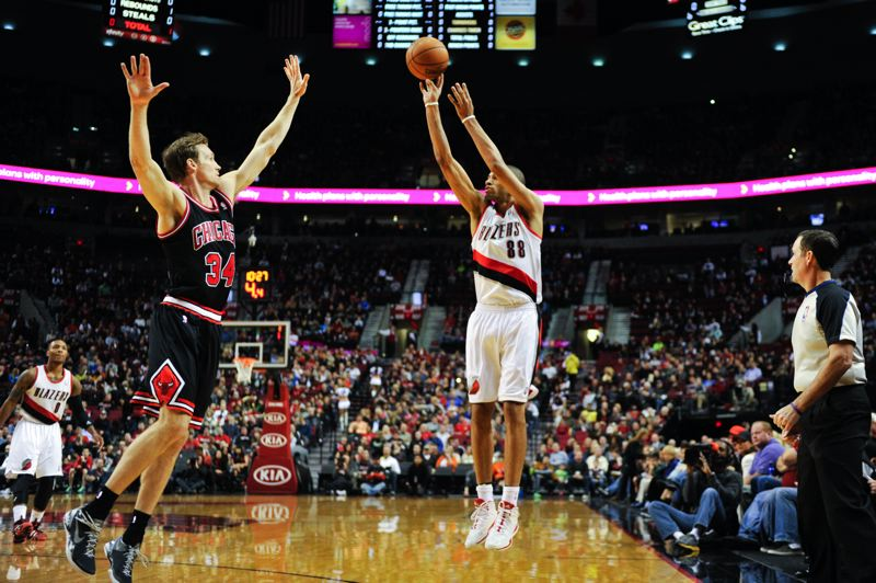 Nicolas Batum of the Blazers has room to shoot a long jumper over Chicago's Mike Dunleavy Jr.