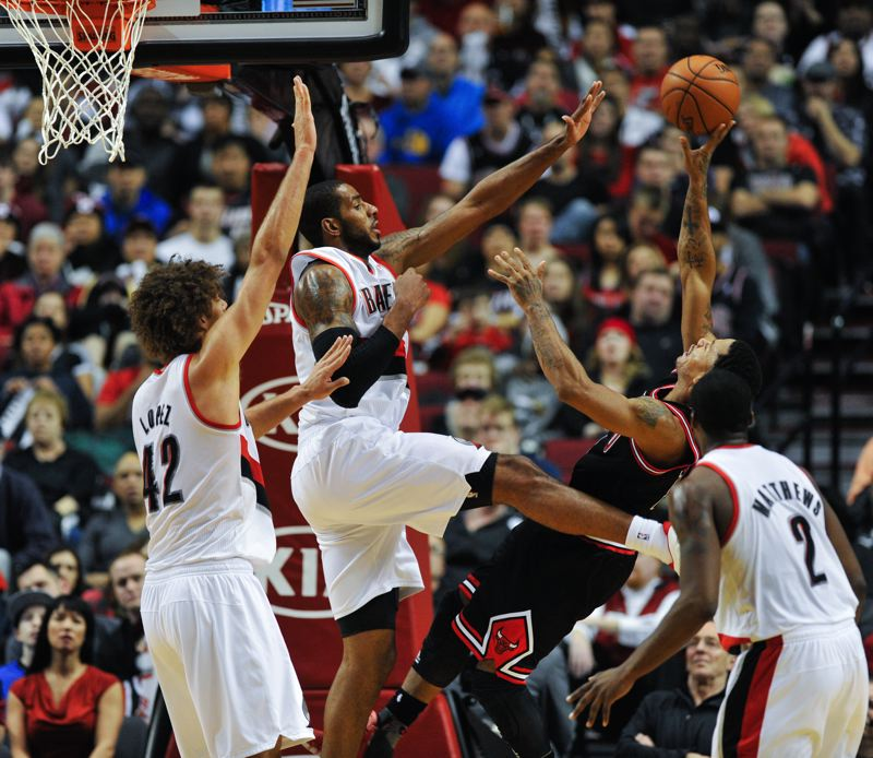 LaMarcus Aldridge contests a fading shot by Bulls star Derrick Rose.