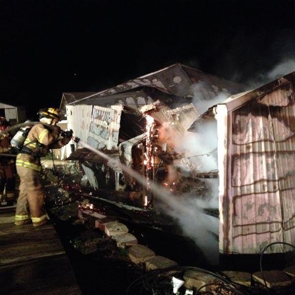 by: TUALATIN VALLEY FIRE & RESCUE - Firefighters battle a blaze in a barn near West Linn Friday evening.