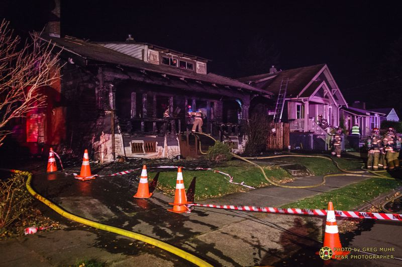 by: PORTLAND FIRE & RESCUE - These two Southeast Portland homes wer damaged by fire Saturday night.