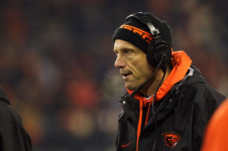 by: TRIBUNE PHOTO: JAIME VALDEZ - Oregon State coach Mike Riley, watching the second half unfold during Saturday night's home loss to Washington, tackles numerous questions the day after the Beavers' loss and looking ahead to Friday's Civil War game at Oregon.