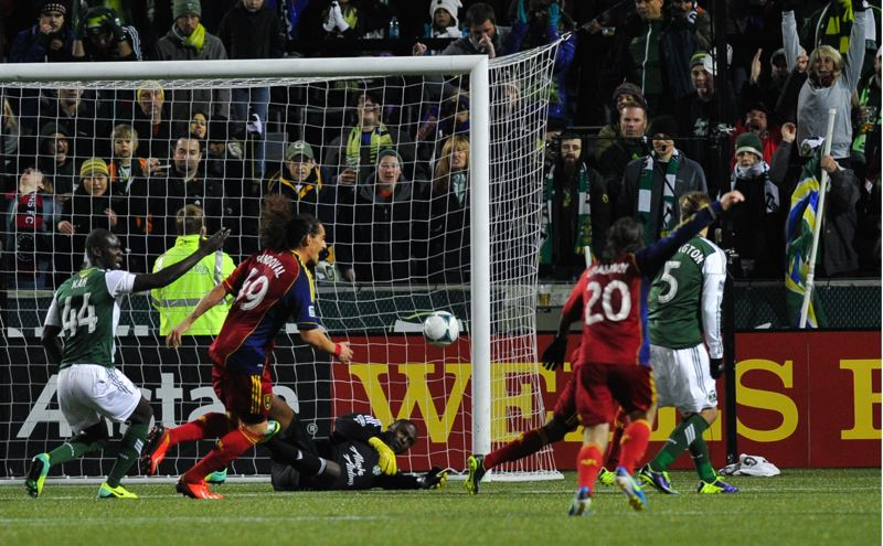 by: COURTESY OF JOHN LARIVIERE - Real Salt Lake players celebrate their goal in the 29th minute Sunday night at Jeld-Wen Field.