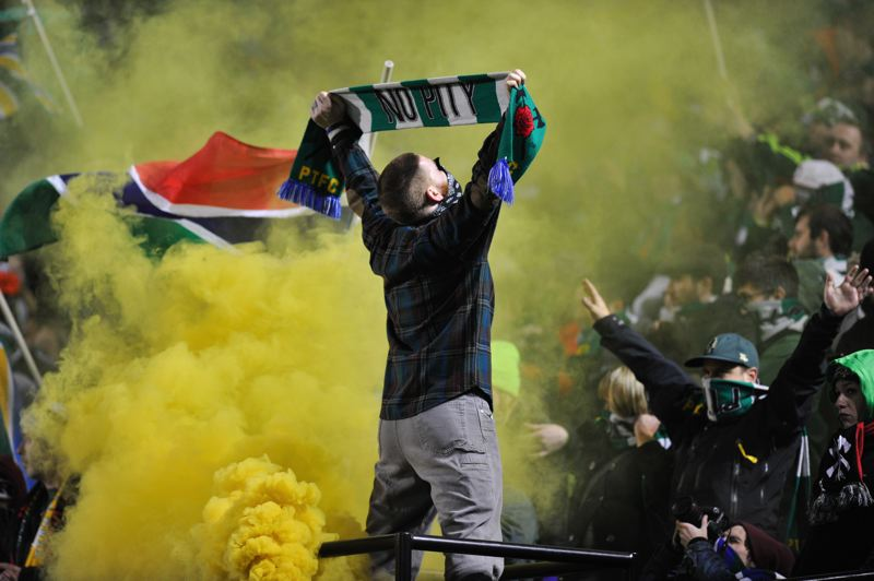 Late in the game, with all about lost, the Timbers Army releases its smoke.