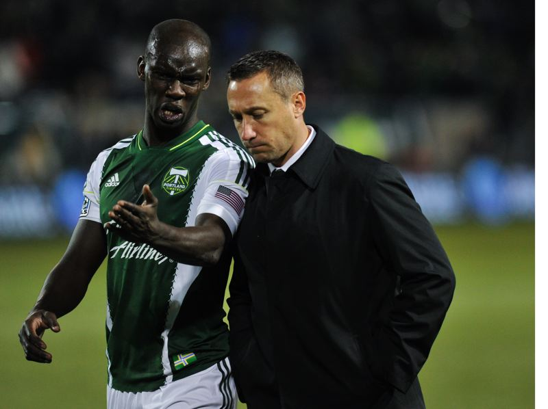 by: COURTESY OF JOHN LARIVIERE - Portland defender Pa Modou Kah talks to Timbers coach Caleb Porter as the game fails to go the home team's way.