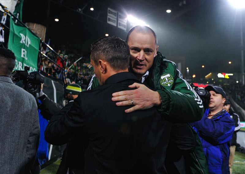 by: COURTESY OF JOHN LARIVIERE - Timbers coach Caleb Porter gets a hug from owner Merritt Paulson after the season-ending loss to Real Salt Lake.