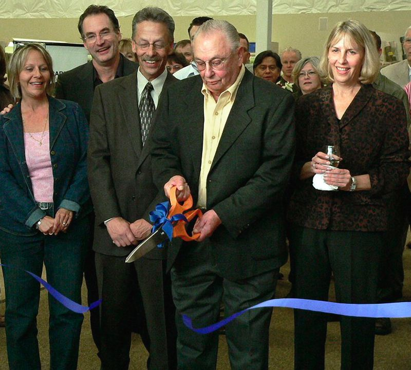 by: CONTRIBUTED PHOTO - At a ribbon cutting for the Tigard Crown Carpets grand reopening in 2005, Lepper was joined by his family (left to right): Mary Lepper Kempenich, secretary-treasurer; David Kempenich, Gresham operations manager; Doug Lepper, president; Lepper, founder and chairman emeritus; and Debra Lepper, vice president.
