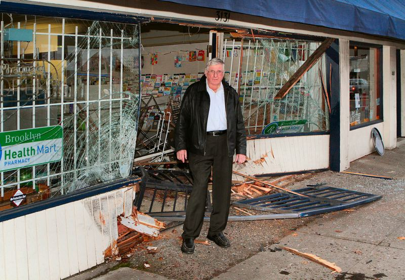 by: DAVID F. ASHTON - Moments after the pickup truck was pulled back out of the building by a tow truck, Brooklyn Pharmacy owner Mike Dardis stood ruefully in what used to be the front doorway.