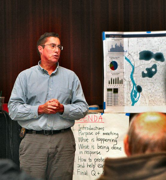 by: DAVID F. ASHTON - Portland Police Officer John Fulitano discusses a map of the the tire vandalism crimes.