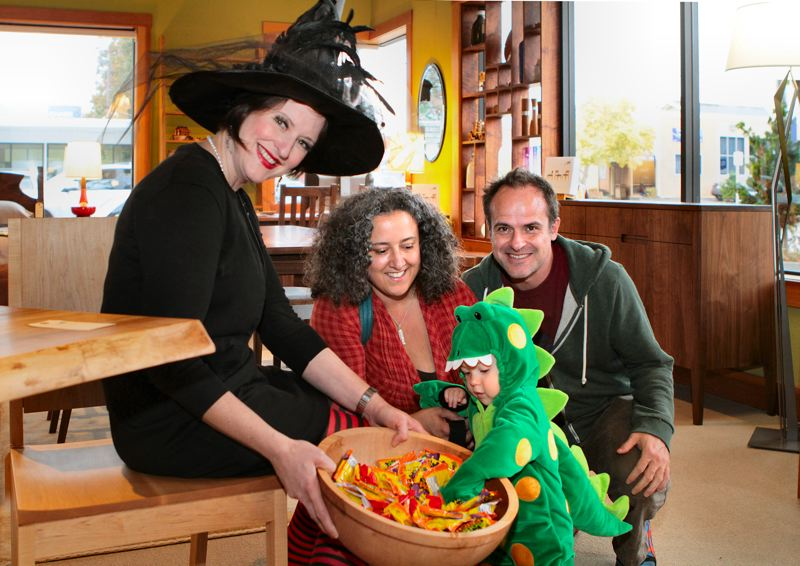 by: DAVID F. ASHTON - At The Joinery, lovely Witchiepoo Wendy Weaver serves up treats to green dragon Nico Allison, Jeanna Nicotera, and David Allison, on their way to the Woodstock Community Center Halloween party.