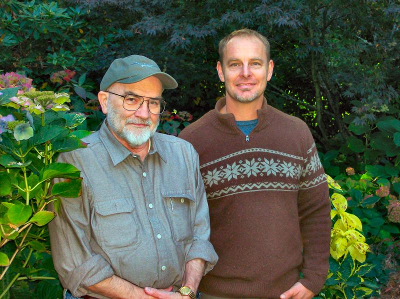 by: RITA A. LEONARD - Author Ted Mahar (in hat) and Doug the Wonder Guy still enjoy the late Dulcy Mahars garden in Garthwick, at the south end of Sellwood.