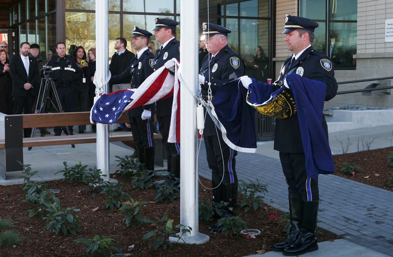 by: OUTLOOK PHOTO: JIM CLARK - Instead of a ribbon cutting at the dedication of the new Rockwood Public Safety Facility, the police honor guard performed a flag raising, followed by the Pledge of Allegiance.