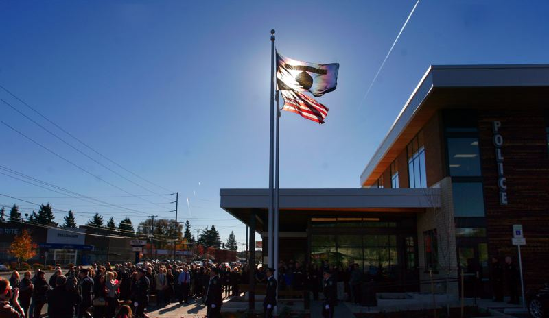 by: OUTLOOK PHOTO: JIM CLARK - A crowd gathers for the flag raising at Gresham's new police station Thursday.