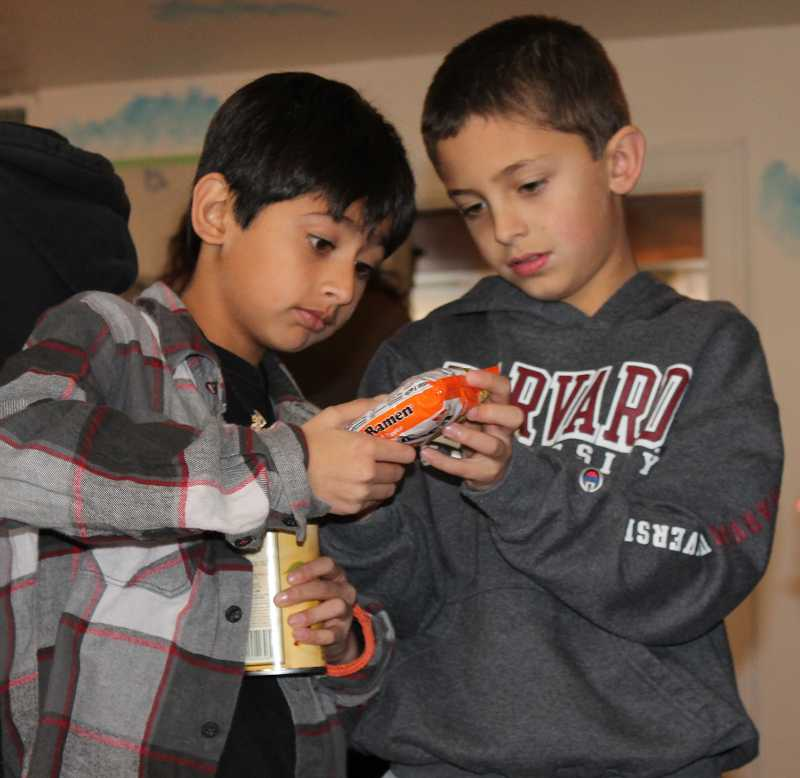 by: TIDINGS PHOTO: KATE HOOTS - Moiz Tremazi, left, and Garrett Jackson visit the West Linn Food Pantry on Friday with their class of Trillium Creek Primary School fourth-graders.