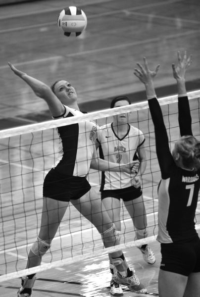by: NEWS-TIMES PHOTO: ZACK PALMER - Banks sophomore Megan Bunn (6) goes up for a spike during the Class 4A volleyball state tournament earlier this month.