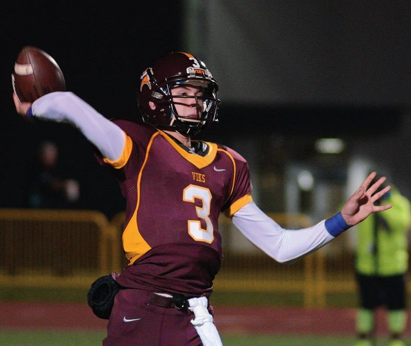 by: NEWS-TIMES PHOTO: CHASE ALLGOOD - Forest Grove quarterback Taylor Jensen throws a pass during the Vikings' regular-season finale against Tigard. Forest Grove won four games and tied for sixth in the conference.