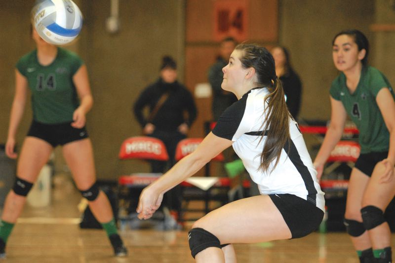 by: ESTACADA NEWS: DAVID BALL - Estacada graduate Haley Lusher, a libero at Highline CC, gets in position for a dig during the teams first-round win over Yakima Valley.