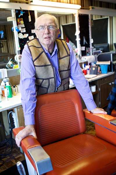 by: TIMES PHOTO: JAIME VALDEZ - John Hittner, owner of Studio Barber Shop in downtown Beaverton, recalls where he was on Nov. 22, 1963, when President Kennedy was assassinated.