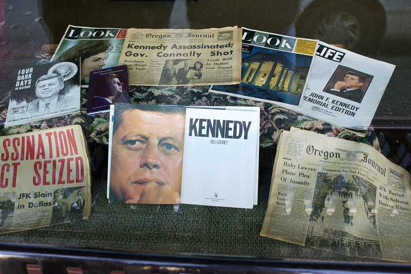 by: TIMES PHOTO: JAIME VALDEZ - Memorabilia documenting President John F. Kennedy's assassination 50 years ago occupies the window display at the Beaverton History Center on Southwest Broadway Street.
