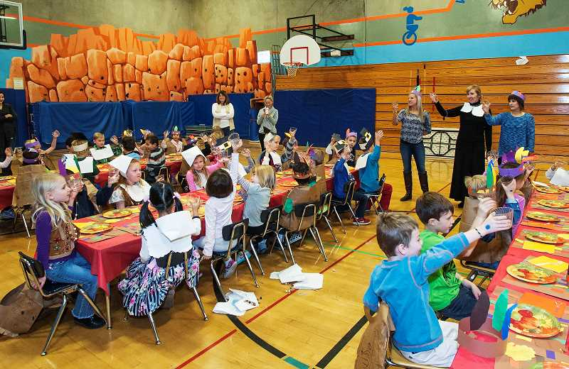 by: JOSH KULLA - Westridge Elementary School kindergarten teachers - from left, Tina Johnson, Kelly Troike, Jennifer Pasternak - toasted their students during a special Thanksgiving event Nov. 22 during which students learned about the history of the turkey holiday and enjoyed a meal.