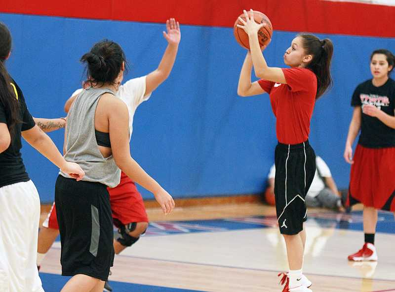 by: BILLY GATES/THE PIONEER - Madras High School junior point guard Mariah Stacona pulls up for a jump shot during practice on Monday at Madras High School. Stacona, a first-team all-conference player last year, will help lead the White Buffalos this season.
