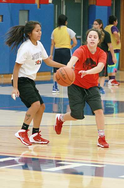 by: BILLY GATES/THE PIONEER - Madras guard Vanessa Esquivel tries to pass around the defense.
