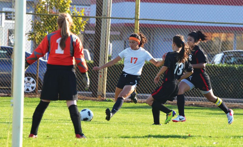 by: FILE PHOTO - Scappoose alumnus Ariel Viera (17) takes a shot against Tillamook at home last season. Viera would score her 100th career goal minutes later, and now has a chance to make the U-20 Women's National Team roster.