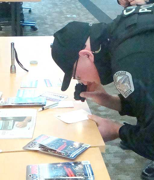by: JOHN BAKER - With the CopDot program, Canby police will be better able to identify people's lost or stolen property by looking through a magnifying device that reveals the 'dot' and its personalized identification numbers.