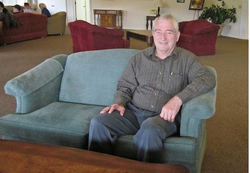 by: BARBARA SHERMAN - FOLLOWING IN FAMOUS FOOTSTEPS - Paul Hailey, whose book on his great-great-grandfather is now on sale, relaxes in the King City Clubhouse living room.