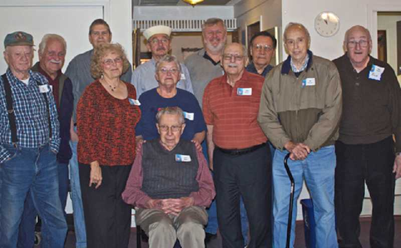 by: JEAN LEIDINGER/FOR THE REGAL COURIER - TIME TO REMEMBER - The Eldorado Villas veterans attending the recognition breakfast gather for a group photo to mark the occasion.