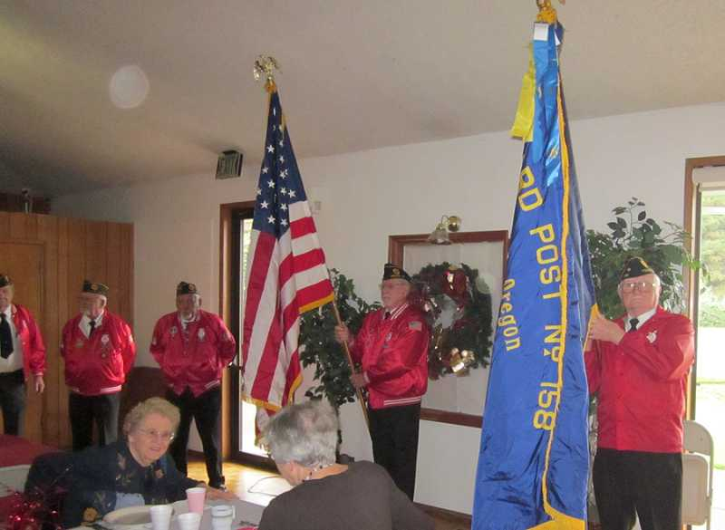 by: BARBARA SHERMAN - RED, WHITE AND BLUE ARE COLORS OF THE DAY - At the Royal Villas Clubhouse, the Tigard American Legion Post 158 color guard posts the colors at the beginning of the event.
