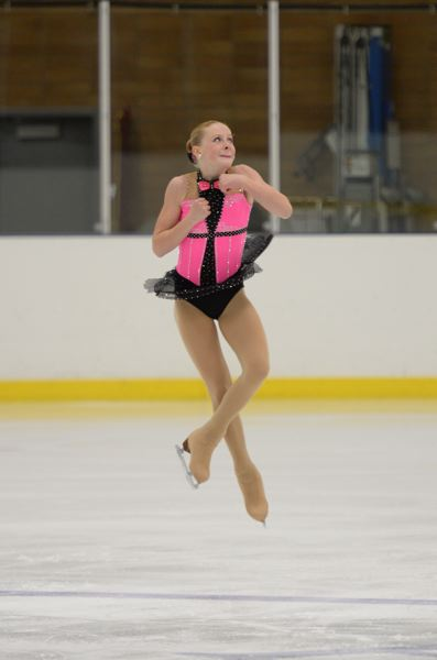 Lake Oswego's Nykki Olejniczak completes a jump during a recent routine. She recently qualified for the Pacific Sectional Figure Skating Championships.