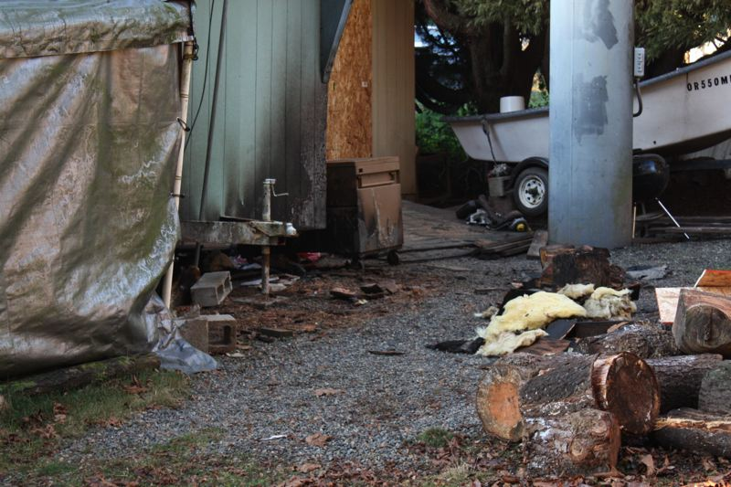 by: SPOTLIGHT PHOTO: ROBIN JOHNSON - Scappoose Rural Fire District officials said that aside from the slight charring on the outside of the home, the propane explosion caused relatively little damage to the structure.