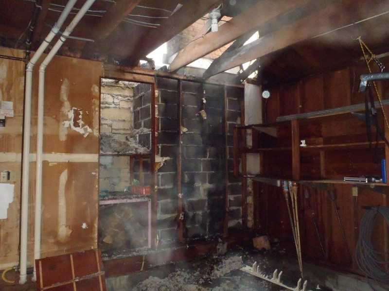 by: TUALATIN VALLEY FIRE & RESCUE - A fire investigator determined the cause of the blaze was accidental and originated in the fireplace.