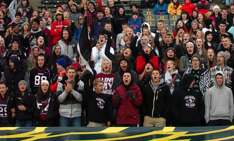 by: DAN BROOD - STRONG SUPPORT -- Sherwood High School students cheer on the Bowmen during Saturday's state playoff semifinal game at Autzen Stadium. Sherwood will play West Albany for the state title Saturday.