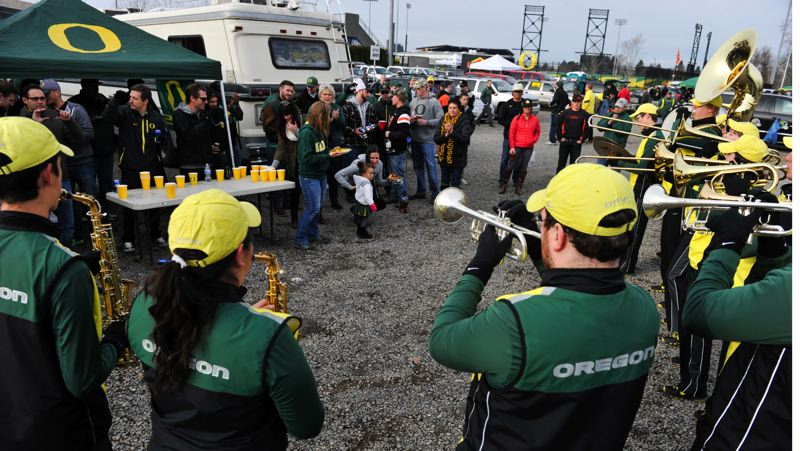 by: COURTESY OF JOHN LARIVIERE - The Oregon band plays for tailgaters.