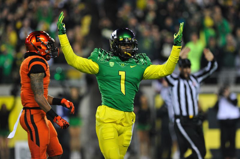 by: COURTESY OF JOHN LARIVIERE - Oregon receiver Josh Huff celebrates a long catch in the first half.