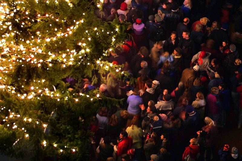 by: TRIBUNE PHOTO - Portland-area residents celebrated Friday evening the city's Christmas Tree in Pioneer Courthouse Square.