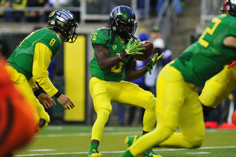 by: COURTESY OF JOHN LARIVIERE - De'Anthony Thomas bobbles the ball before gaining control and scoring midway through the first quarter for Oregon.