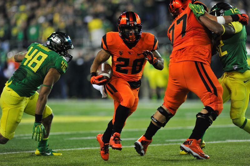 by: COURTESY OF JOHN LARIVIERE - Oregon State's Terron Ward finds a good hole in the first half.