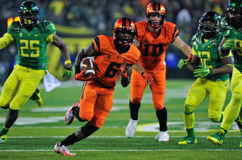 by: COURTESY OF JOHN LARIVIERE - Victor Bolden scores on a 25-yard run with 1:38 remaining, giving Oregon State a 35-30 lead in Friday's Civil War at Autzen Stadium. Oregon rallied to win 36-35.
