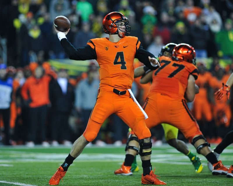 by: COURTESY OF JOHN LARIVIERE - OSU quarterback Sean Mannion unleashes a pass on the Beavers' go-ahead drive late in the fourth quarter.