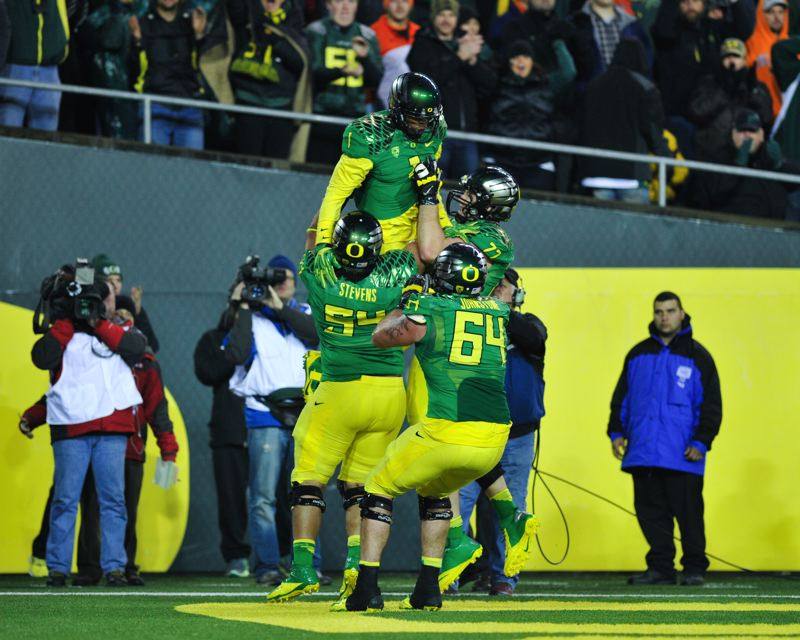 by: COURTESY OF JOHN LARIVIERE - Oregon's Josh Huff gets a lift from some offensive linemen after catching a touchdown pass with 7:56 left.