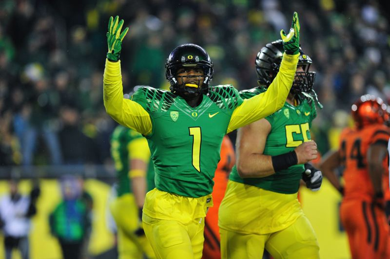 by: COURTESY OF JOHN LARIVIERE - Josh Huff signals to the crowd after his TD catch with 7:56 left in Friday's game put Oregon on top 30-29.