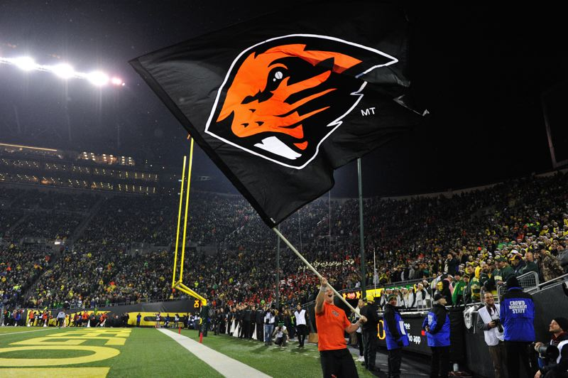 by: COURTESY OF JOHN LARIVIERE - The Beaver banner gets a run at Autzen Stadium.