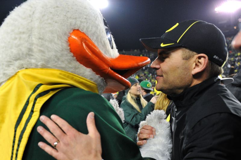 by: COURTESY OF MEG WILLIAMS - A relieved Oregon coach Mark Helfrich meets the Oregon mascot on the field after the game's final play.